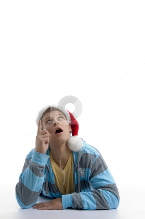 Man pointing upward and wearing christmas hat stock photo, Man pointing upward and wearing christmas hat with white background by Imagery Majestic