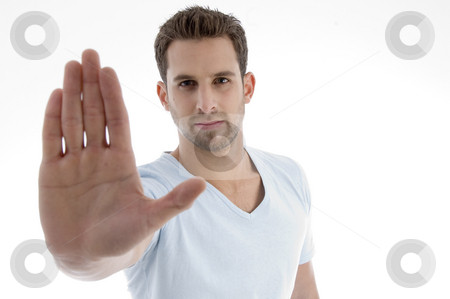 Young man showing stop gesture  stock photo, Young man showing stop gesture on an isolated white backgound by Imagery Majestic