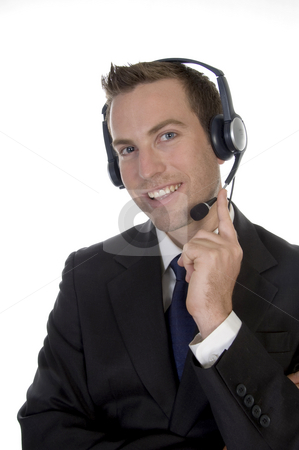 Young man calling with headset and smiling stock photo, Young man calling with headset and smiling on white background by Imagery Majestic
