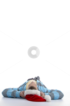 Laying man with christmas hat stock photo, Laying man with christmas hat against white background by Imagery Majestic
