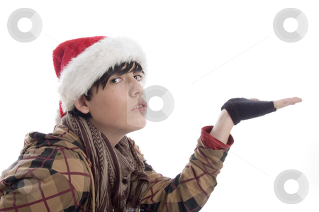 Young boy wearing christmas hat showing palm stock photo, Young boy wearing christmas hat showing palm on an isolated background by Imagery Majestic