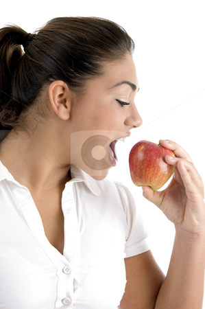 Young female going to eat apple stock photo, Young female going to eat apple on an isolated white background by Imagery Majestic