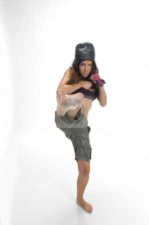 Female fighter kicking stock photo, Front view of female fighter kicking by Imagery Majestic