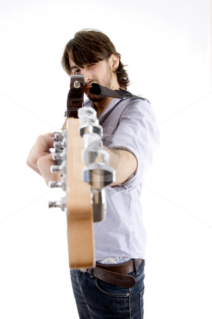 Young fellow holding guitar like gun stock photo, Young fellow holding guitar like gun on an isolated white background by Imagery Majestic