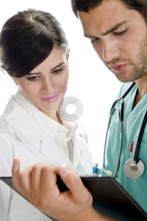 Medical professionals looking in writing pad stock photo, Medical professionals looking in writing pad against white background by Imagery Majestic