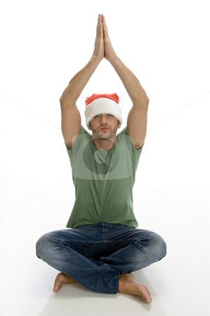 Praying man with santa cap stock photo, Praying man with santa cap with white background by Imagery Majestic