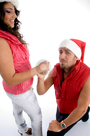 Man proposing to the woman with christmas hat stock photo, Man proposing to the woman with christmas hat with white background by Imagery Majestic