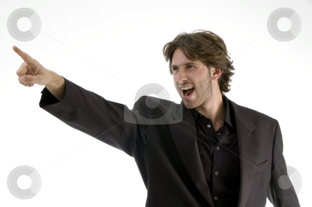 Shouting man pointing sideways stock photo, Shouting man pointing sideways on an isolated background by Imagery Majestic