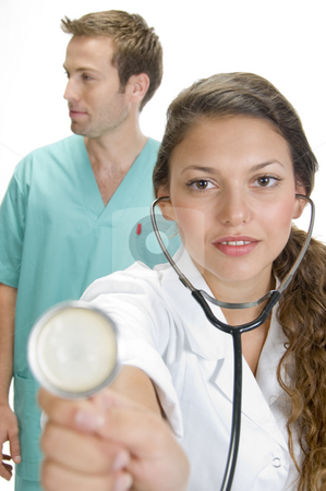 Close up of smiling lady doctor with stethoscope and male doctor stock photo, Close up of smiling lady doctor with stethoscope and male doctor by Imagery Majestic