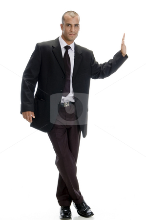 Businessman looking at camera stock photo, Businessman looking at camera and stopping some one by Imagery Majestic