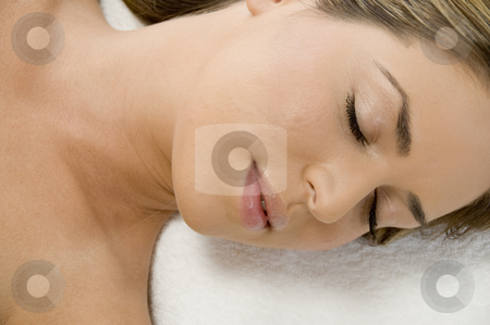 Close view of sleeping young lady stock photo, Close view of sleeping young lady by Imagery Majestic