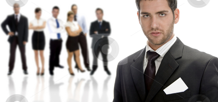 Posing handsome businessman stock photo, Posing handsome businessman with large group by Imagery Majestic