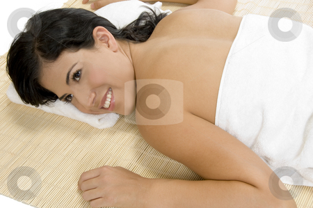 Happy woman laying on bamboo mat stock photo, Happy woman laying on bamboo mat by Imagery Majestic