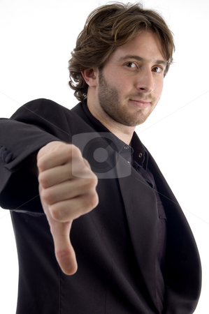 Man showing disapproval sign stock photo, Man showing disapproval sign with white background by Imagery Majestic
