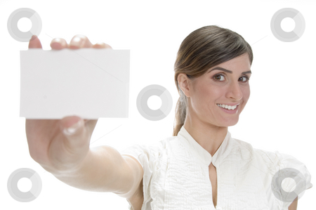 Smiling lady showing visiting card stock photo, Smiling lady showing visiting card on an isolated white background by Imagery Majestic