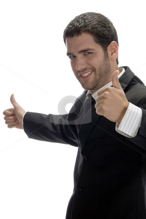Happy businessman wishing good luck stock photo, Happy businessman wishing good luck on an isolated white background by Imagery Majestic