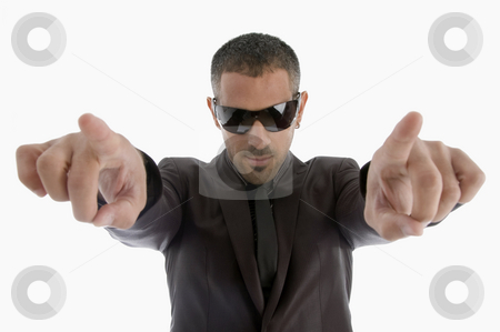 Indicating businessman with sunglasses stock photo, Indicating businessman with sunglasses on an isolated white background by Imagery Majestic