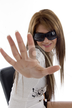 Charming female showing her palm stock photo, Charming female showing her palm against white background by Imagery Majestic