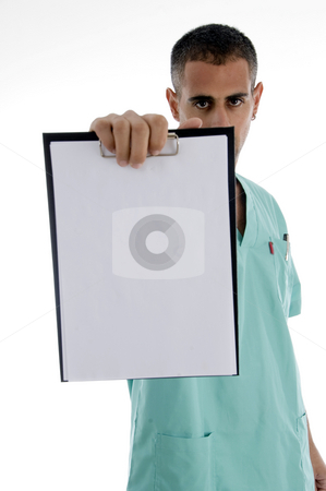Male doctor showing notepad stock photo, Male doctor showing notepad on an isolated background by Imagery Majestic