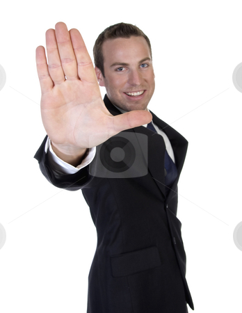 Attractive man stopping someone stock photo, Attractive businessman stopping someone by Imagery Majestic