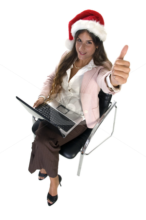 Businesswoman wishing good luck stock photo, Businesswoman wishing good luck smiling lady with santacap by Imagery Majestic