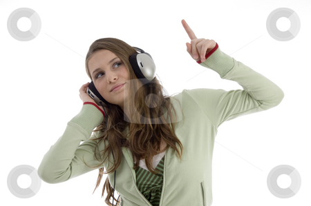 Woman in dancing posture while listening music stock photo, Woman in dancing posture while listening music isolated with white background by Imagery Majestic