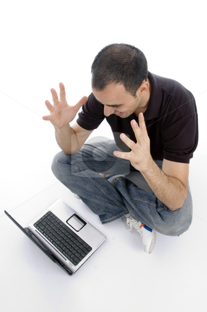 Pleased man looking to laptop stock photo, Pleased man looking to laptop on an isolated background by Imagery Majestic