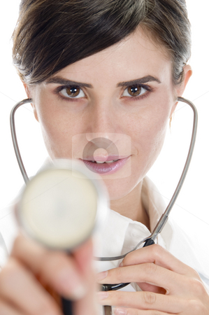 Lady doctor posing with stethoscope stock photo, Lady doctor posing with stethoscope on an isolated background by Imagery Majestic