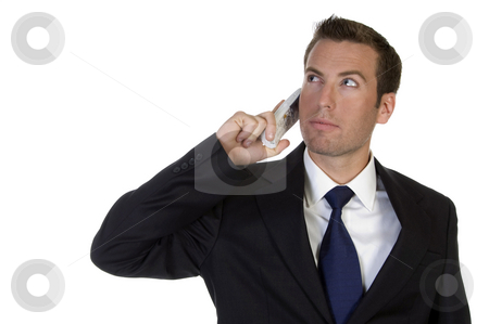 Portrait of young businessman with mobile stock photo, Portrait of young businessman with mobile against white background by Imagery Majestic
