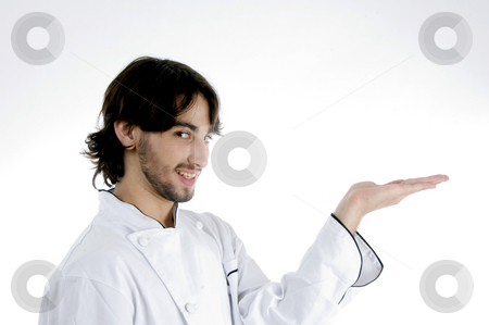 Young chef with open palm stock photo, Young chef with open palm on an isolated white background by Imagery Majestic
