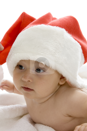 Cute young baby wearing santa cap stock photo, Cute young baby wearing santa cap against white background by Imagery Majestic