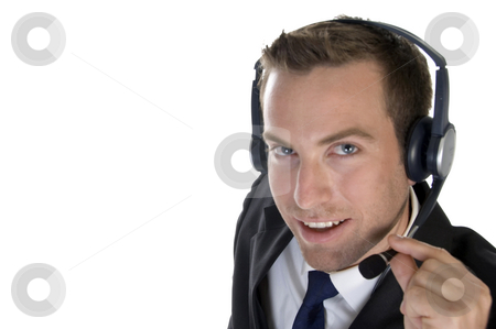 Smiling businessman with headphone stock photo, Smiling businessman with headphone on an  isolated background by Imagery Majestic
