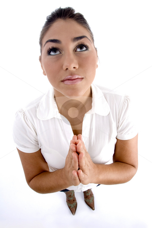 Praying young woman stock photo, Praying young woman on an isolated background by Imagery Majestic
