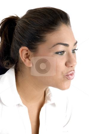 Woman making kissing gesture stock photo, Woman making kissing gesture with white background by Imagery Majestic