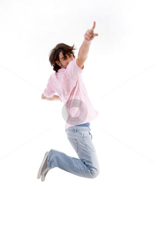 Jumping man pointing you stock photo, Jumping man pointing you against white background by Imagery Majestic