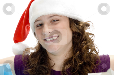 Cheerful woman with santa cap stock photo, Cheerful woman with santa cap on an isolated background by Imagery Majestic