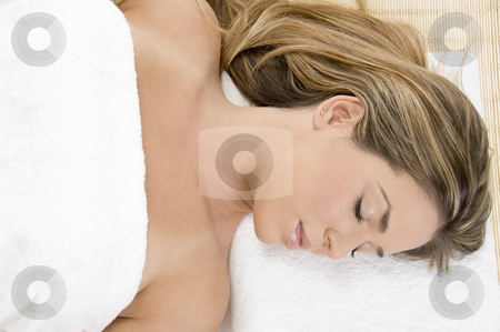 Sleeping young female in towel stock photo, Sleeping young female in towel by Imagery Majestic