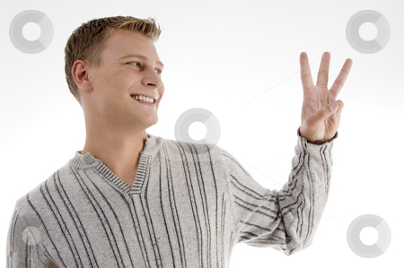 Man with counting hand gesture stock photo, Man with counting hand gesture on an isolated background by Imagery Majestic