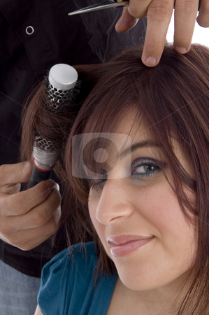 Female taking haircut stock photo, Female taking haircut against white background by Imagery Majestic