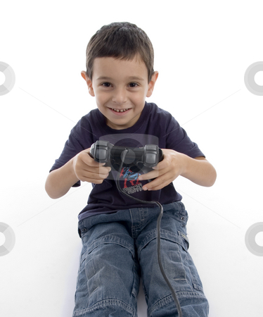 Young boy playing video game stock photo, Young boy playing video game on an isolated white background by Imagery Majestic