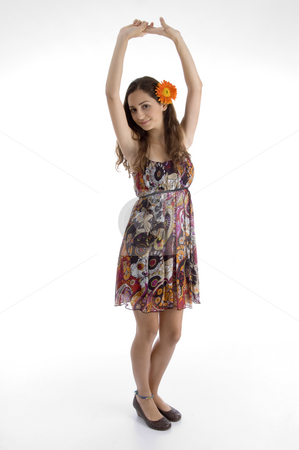 Full body pose of young woman with flower in hair stock photo, Full body pose of young woman with flower in hair against white background by Imagery Majestic