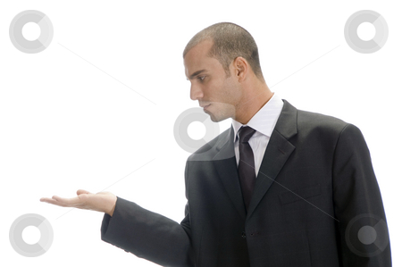 Young caucasian man posing stock photo, Young caucasian man posing like holding something by Imagery Majestic