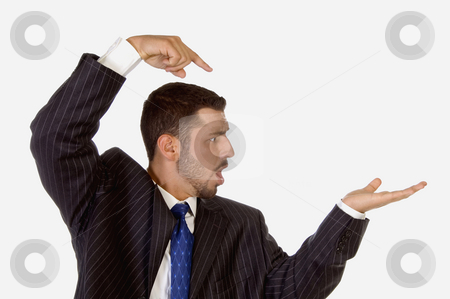 Surprised businessman pointing his palm stock photo, Surprised businessman pointing his palm on an isolated white background by Imagery Majestic