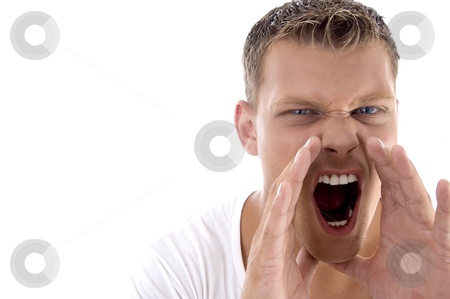 Young fellow shouting loudly stock photo, Young fellow shouting loudly on an isolated white background by Imagery Majestic