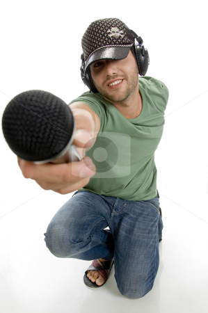 Smart male showing microphone stock photo, Smart male showing microphone on an isolated white background by Imagery Majestic