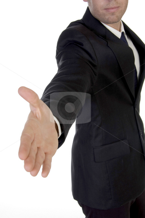 Young man in suit offering to shake the hand stock photo, Young man in suit offering to shake the hand on an isolated white background by Imagery Majestic