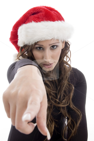 Woman wearing christmas hat pointing you stock photo, Woman wearing christmas hat pointing you with white background by Imagery Majestic