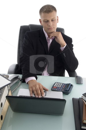 Businessman working on laptop stock photo, Businessman working on laptop on an isolated white background by Imagery Majestic