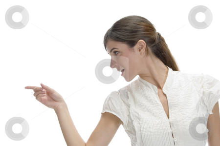 Indicating woman looking side stock photo, Indicating woman looking side on an isolated white background by Imagery Majestic