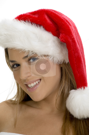 Posing smiling lady with santa cap stock photo, Posing smiling lady with santa cap by Imagery Majestic